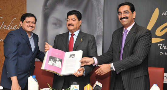 The book is launched - Dr. Mandar with Dr. B.R. Shetty and Mr.Sudhir Shetty